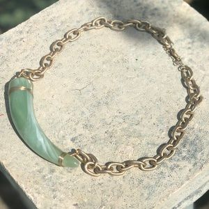 Choker with green tooth detail